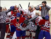 Officials try to separate Canadiens and Hurricanes during a second-period melee. Carolina won the opening game of the Eastern Conference semifinal series, 2-0, on Friday in Raleigh, N.C.