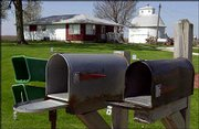 Residents outside Morrison, Ill., leave their mailbox doors open so officials can check inside them. Postal officials said Sunday that mail would be delivered in rural areas where pipe bombs were discovered only to mailboxes with the doors left open.