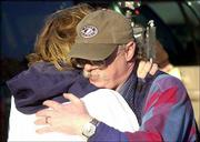 Georgia's chief medical examiner, Kris Sperry, right, a Lawrence native, comforts Colleen Blankenship after the remains of Blankenship's mother were identified in February at the Tri-State Crematory in Noble, Ga.