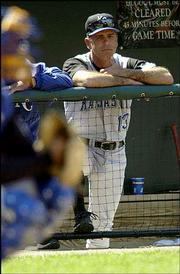 Interim manager john mizerock watches the Royals' sixth straight loss.