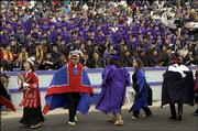 Members of the Yun Shu Ka Dancers, from Alaska, perform at Haskell Indian Nations University commencement ceremony Friday.