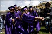 A group of graduates gather after the Haskell commencement ceremony.