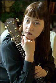 "Singer-songwriter Suzanne Vega is promoting a new collection of folk songs by various artists about the Sept. 11 attacks. ""Vigil"" is available at amazon.com."
