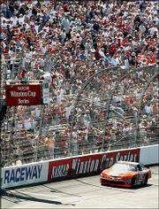 Tony Stewart crosses the finish line to win the NASCAR Pontiac Excitement 400 at Richmond International Raceway in Richmond, Va. NASCAR races are expected to be a top draw for family vacations this summer.