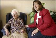 Rhonda Parks, the new executive director at Lawrence Presbyterian Manor, visits with 93-year-old resident Florence Sandberg. Lawrence Presbyterian Manor is following the trend to provide a more homelike atmosphere at its facilities.