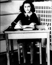ANNE FRANK, shown in an undated file photo, kept a diary while her family hid from the Nazis in Amsterdam, Netherlands, during World War II. Biographer Carol Ann Lee has published a new theory saying a former business associate of Frank's father tipped off the Franks' hideout to the Nazis.