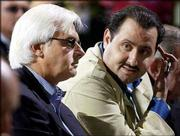 Trainer Bob Baffert, left, and owner Prince Ahmed Salman, from Saudi Arabia, contemplate the post position of Kentucky Derby entrant War Emblem during the Derby draw. Next Saturday, recently acquired War Emblem tries to win the Preakness and move within a victory in the Belmont Stakes of becoming the first Triple Crown winner since Affirmed in 1978.