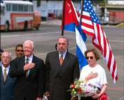 Former U.S. President Jimmy Carter, center left, stands at attention during the playing of the U.S. national anthem with Cuban President Fidel Castro and former first lady Rosalynn Carter. The Carters arrived Sunday in Havana. Carter is the first U.S. president, in or out of office, to visit Cuba since the 1959 revolution that put Castro in power.