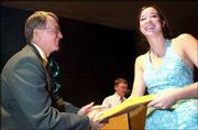 Kate Myrick receives her copy of a President's Award for Educational Excellence from Free State High School Principal Joe Snyder. About 150 students from the FSHS senior class were recognized at an honors ceremony Monday night.