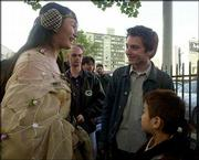 "In costume, Mariko Yasu, left, greets actor Elijah Wood, center, with Ibuki Ito, 7, right, while waiting for the midnight screening of ""Star Wars: Episode II Attack of the Clones,"" outside Grauman&squot;s Chinese Theater in Hollywood. Wood was waiting Wednesday along with friends in lawn chairs."