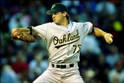 Oakland's Barry Zito delivers against Boston. Zito allowed five hits in eight innings as the Athletics blanked the Red Sox, 5-0, Thursday night in Boston.