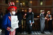 Traditionally clad lobbyists stand around the rotunda of the Statehouse while Topeka business owner Philip Skow, dressed in an Uncle Sam costume, takes a different approach to getting his anti-tax message noticed. Skow, who owns a costume rental and magic shop, wanted legislators who were in their 106th day of the session to know how he felt about taxes.