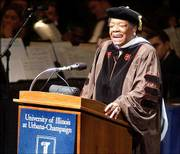 Maya Angelou sings during a recent speech at the University of Illinois. Angelou agreed Thursday to amend a line in a quotation on a slavery monument in Savannah, Ga.