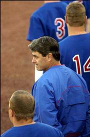 Kansas coach Bobby Randall watches the Jayhawks' loss to Kansas State. The Wildcats beat KU, 11-9, on Saturday at Hoglund Ballpark.