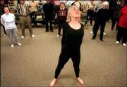 "Former dancer Ann Smith leads a stretch class at Munson Community Health Center in Traverse City, Mich. Smith has advocated fitness training modeled after the slow, rhythmic stretching regimen of classical dancers. ""Exercise is meant to energize you, not exhaust you,"" she says, a message not just for the elderly."