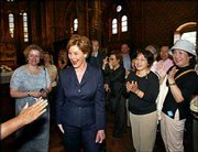 First lady Laura Bush is applauded by dozens of international tourists while visiting the St. Matthias Church in Budapest, Hungary. Later Saturday, Mrs. Bush moved on to Prague, Czech Republic, the last stop on her European tour. Mrs. Bush used the tour to speak out on issues of importance to her including defense of the president.