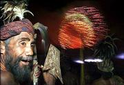 An East Timorese man wearing traditional dress watches a fireworks display after the country became independent. East Timor became the world's newest nation at 12:01 a.m. today.