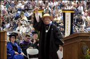 KU Chancellor Robert Hemenway gives a final salute to the class of 2002.