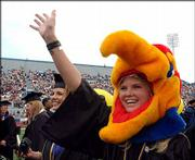 Loyal Jayhawk fan Kelsey Osbourn of Tulsa, Okla., greeted family and friends at Kansas University's 130th commencement. Osbourn earned a degree in business administration and psychology. Sunday's graduation attracted about 30,000 people to KU's Memorial Stadium, where about 4,000 made the traditional walk down Campanile Hill.