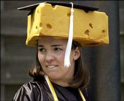 Cheesehead Rebecca Evans of Plover, Wis., surveys the crowd gathering for commencement. Evans, a Green Bay Packers fan, earned a bachelor's degree in political science.