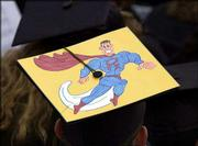 Mortarboards aren't just for having something to attach a tassel to, these Kansas University graduates show. Dozens of graduates participating in Sunday's commencement ceremonies at KU decorated their headgear with messages or artwork.