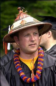 Xavier Stevens, Garnett, wore a straw hat in place of his mortarboard. He was awarded a bachelor's degree in computer science from KU's engineering school.