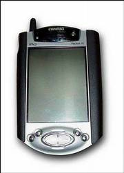 The iPAQ, made by Compaq Computer Corp., allows doctors to view patient information in real time, checking on vital signs, test results and X-rays.