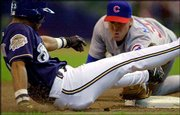 Chicago third baseman Bill Mueller, back, tags out Milwaukee's Alex Sanchez on a steal attempt. The Cubs snapped a nine-game losing streak with a 5-4 victory over the Brewers on Sunday in Milwaukee.