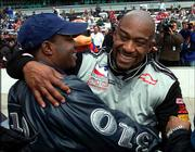 Driver George Mack, right, hugs car owner Marc Laidler. Mack qualified for the Indianapolis 500 with an average speed of 227.150 mph on the final day of qualifying Sunday at the Indianapolis Motor Speedway.