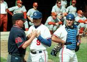 Bobby Randall argues a call with an umpire during a game against Texas. Randall resigned after the Jayhawks completed their fifth straight losing season.
