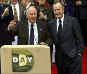 "Stephen Ambrose, historian and founder of the National D-Day Museum, thanks former President George Bush during ceremonies at the museum in this Dec. 7, 2001, file photo, in New Orleans. Ambrose, who wrote the 1994 best seller ""D-Day,"" is working on a new book depicting his own transformation from a left-wing demonstrator to a super patriot."