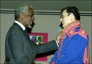 United Nations Secretary General Kofi Annan, left, talks with Ole Henrik Magga of Norway, chairman of the Permanent Forum on Indigenous Issues. Annan addressed the forum Friday at the United Nations headquarters in New York.