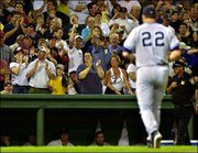Boston Red Sox fans cheer as New York starting pitcher Roger Clemens is pulled in the fourth inning. Clemens gave up seven runs on nine hits in the Yankees' 9-8 11-inning loss Friday in Boston.