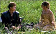 "Actor Hayden Christensen, left, who plays Anikan Skywalker, sits in a field with actress Natalie Portman in a scene from ""Star Wars: Episode II, Attack of the Clones."" Director George Lucas has cautioned fans that ""Star Wars: Episode III"" does not have the happy endings of previous chapters, as Anikan Skywalker transforms into a villainous Darth Vader."