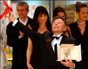 "French Director Roman Polanski reacts as he is awarded the Palme d&squot;Or for the film ""The Pianist"" during the awards ceremony of the 55th Film Festival in Cannes, France. The Palme d&squot;Or is the festival&squot;s top prize."