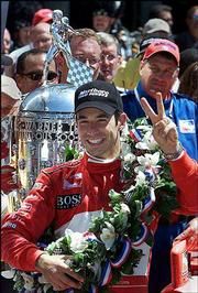 Winner Helio Castroneves celebrates his second consecutive Indianapolis 500 victory after winning Sunday's race.