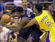 Sacramento's Chris Webber, left, protects the ball while being guarded by Robert Horry of Los Angeles. The Lakers rallied to defeated Sacramento, 100-99, Sunday at Los Angeles and tied the Western Conference finals 2-2. Horry hit the game-winning basket.