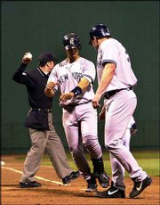 New York's Jason Giambi, right, celebrates his two-run homer with teammate Jorge Posada. The Yankees hit six homers in their 14-5 victory Sunday at Boston.