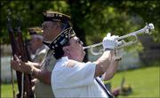 "Bugler Jerry Presley, a Navy veteran of the Korean War and a member of Olathe American Legion Post 153, plays ""Taps."" Lawrence Veterans of Foreign Wars Post 852 played host to the Memorial Day services on Monday at Memorial Park Cemetery."