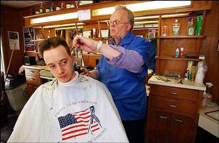 Barber Bob Brown, proprietor of the Hershey Barber Shop, cuts ...