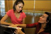 "Actress Sutton Foster, left, goes over a score with composer Janine Tesori in a New York rehearsal studio prior to the opening of Tesori&squot;s new musical ""Thoroughly Modern Millie."" Tesori and Foster are up for Tony Awards, which will be announced today during televised ceremonies."