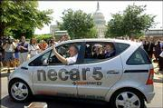 Sen. Carl Levin, D-Mich., left, gives Sen. Debbie Stabenow, D-Mich., in back seat, a spin around Capitol Hill in a DaimlerChrysler methanol-powered necar5. A cross-country trip by the hydrogen-powered fuel cell vehicle ended Tuesday at the Capitol.