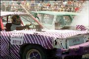 Joe Smith of Kansas City, Kan., watches his car warm up during the first heat of the demolition derby during last year's Tonganoxie Days. This year's festival kicks off today with the Leavenworth County State Barbecue Championship and the first-ever Miss Tonganoxie Pageant.