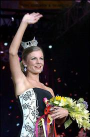 Miss Kansas 2002 Jeanne Anne Schroeder waves to the crowd after being crowned in Pratt.