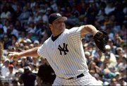 Yankees pitcher Roger Clemens delivers in the second inning. Clemens won his seventh straight decision in a 4-2 victory over the Giants on Sunday in New York.