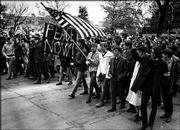 "Kansas University students march on Jayhawk Boulevard in the late 1960s to protest the Vietnam War. Kansas University alumnus Rusty Monhollon, who wrote ""This Is America?: The Sixties in Lawrence, Kansas,"" will read from his work and sign books today at The Raven Bookstore, 8 E. Seventh St."
