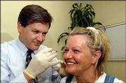 Dr. Daniel Dickerson, Eudora, injects Deay with another shot of Botox. Dickerson has performed Botox treatments to patients dozens of times.