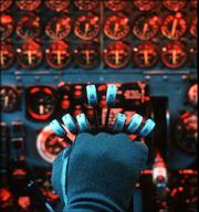 The gloved hand of a pilot holds the controls of the eight engines required to lift the giant B-52 bomber off the runway. During the Cold War B-52's and their crews were on 24-hour alert to deliver nuclear weapons anywhere in the world. The first B-52 was built 50 years ago and many flying today are older than their pilots.