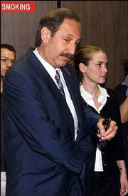 "As actress Winona Ryder&squot;s felony shoplifting case heads to trial and she promotes her new comedy ""Mr. Deeds,"" her jokes about the incident have only rankled prosecutors while failing to create a groundswell of public sympathy. She is shown with her attorney Mark Geragos."