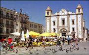 People have their morning coffee in the Giraldo Great Square, in the heart of Evora's historical center, in the Alentejo region of Portugal. The Alentejo offers Roman temples, palaces, centuries-old fortresses and an ancient market town at the heart of Portugal's wine industry.